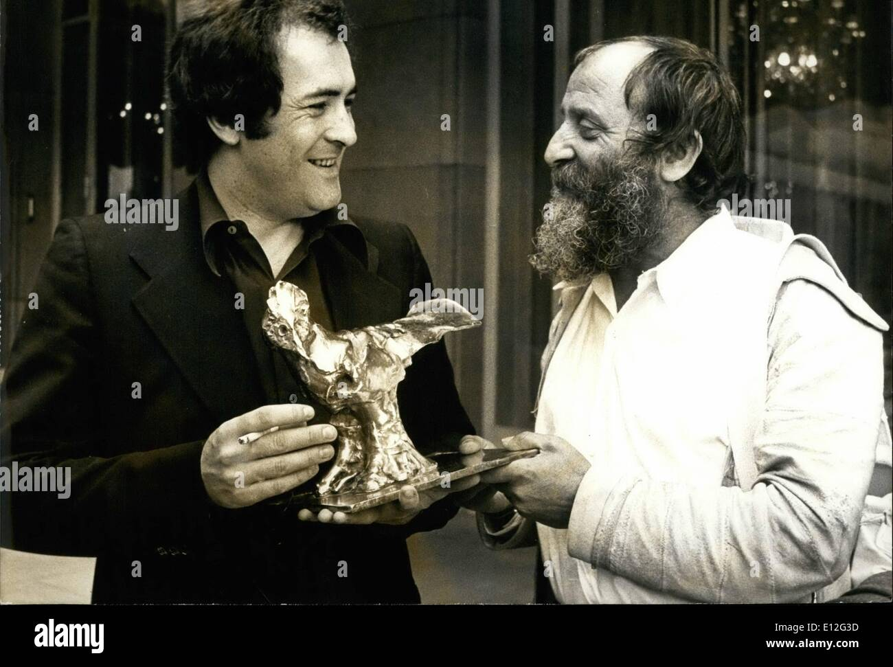 Dec. 26, 2011 - Bernardo Bertolucci with his ''Bird'' sculpted by Cezar for his film the last tango the prize of the ''Prix Raoul Levy'' Given out each year for the best Mis En scene of the year - Stock Image