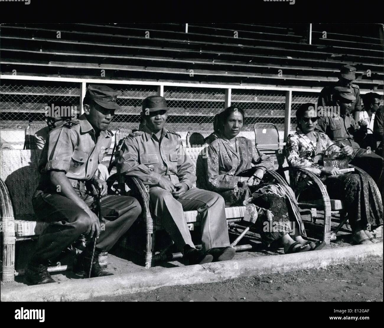 Dec. 26, 2011 - Indonesian Personalities: Watching the installation ceremony of the new Central Sumatran military commander at Padang are 1 - r: Col. Achmad Jani, Lt. Gen. Nasution (Chief of Staff) Mrs. Kharuddin (wife of the Governor) and Mrs. Nasution, whose mother is Dutch. - Stock Image