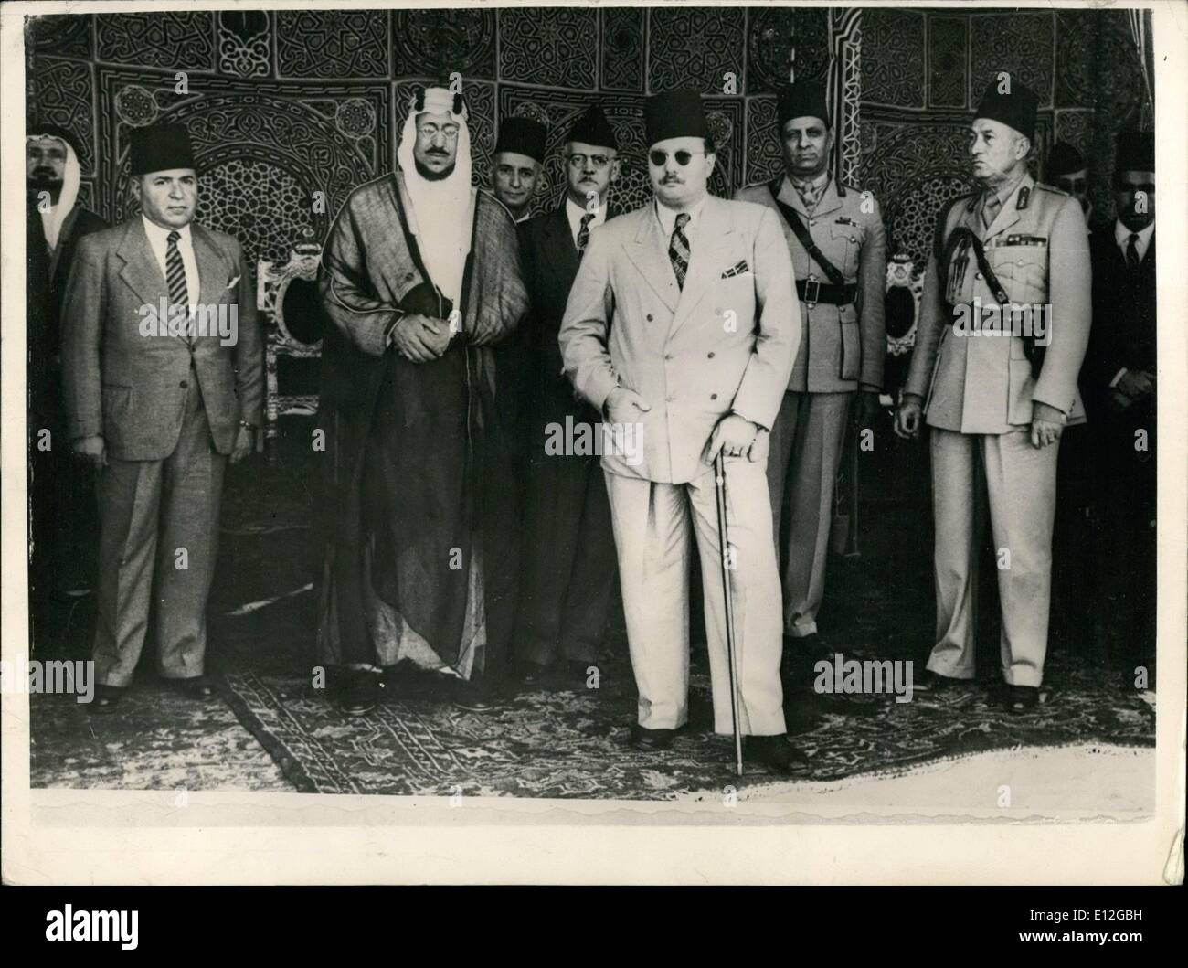 Dec. 26, 2011 - Conclaves of Arab Kings and Rulers: Heads of Arab States was reed at King Farduk's Palace, at Inchass, Near Cairo, on AY 28th and 29th. The meeting which had been called by the King of Egypt, was attended by the new King of Transdah,  Dullan Prince Abdul , regent of Iraq; Sheik  at Khoury, Lebanese president; Shuery ey al Kuwatly, Syrian Presidnt , Prince Soud, ledest son of King IBM Seoud and Prince if EL islam, Eldest son of the Isam of Yemen. Picture Shows: King Farouk waits for his Guesy. standing next to new is Prince Seoud, heir to the Hedjaz Throne. - Stock Image