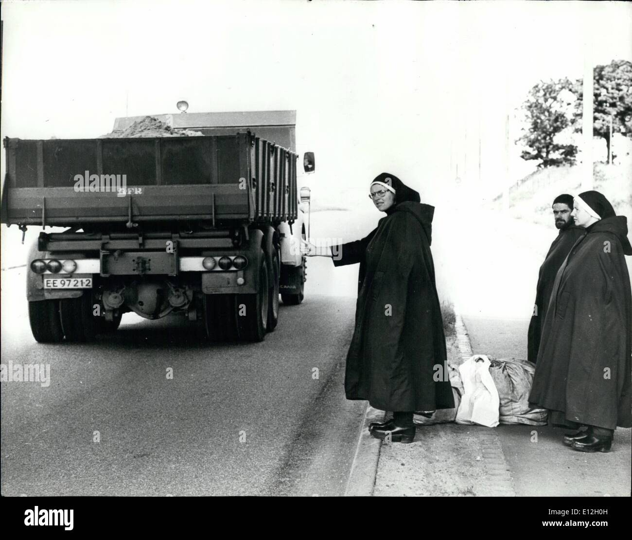 Jan. 10, 2012 - Praying for a Life: Praise the Lord, 'and give us a lift', say these two Nuns and a Monk, as they stand at a Dabish roadside. The party had hitch hiked all the way from Ireland. - Stock Image