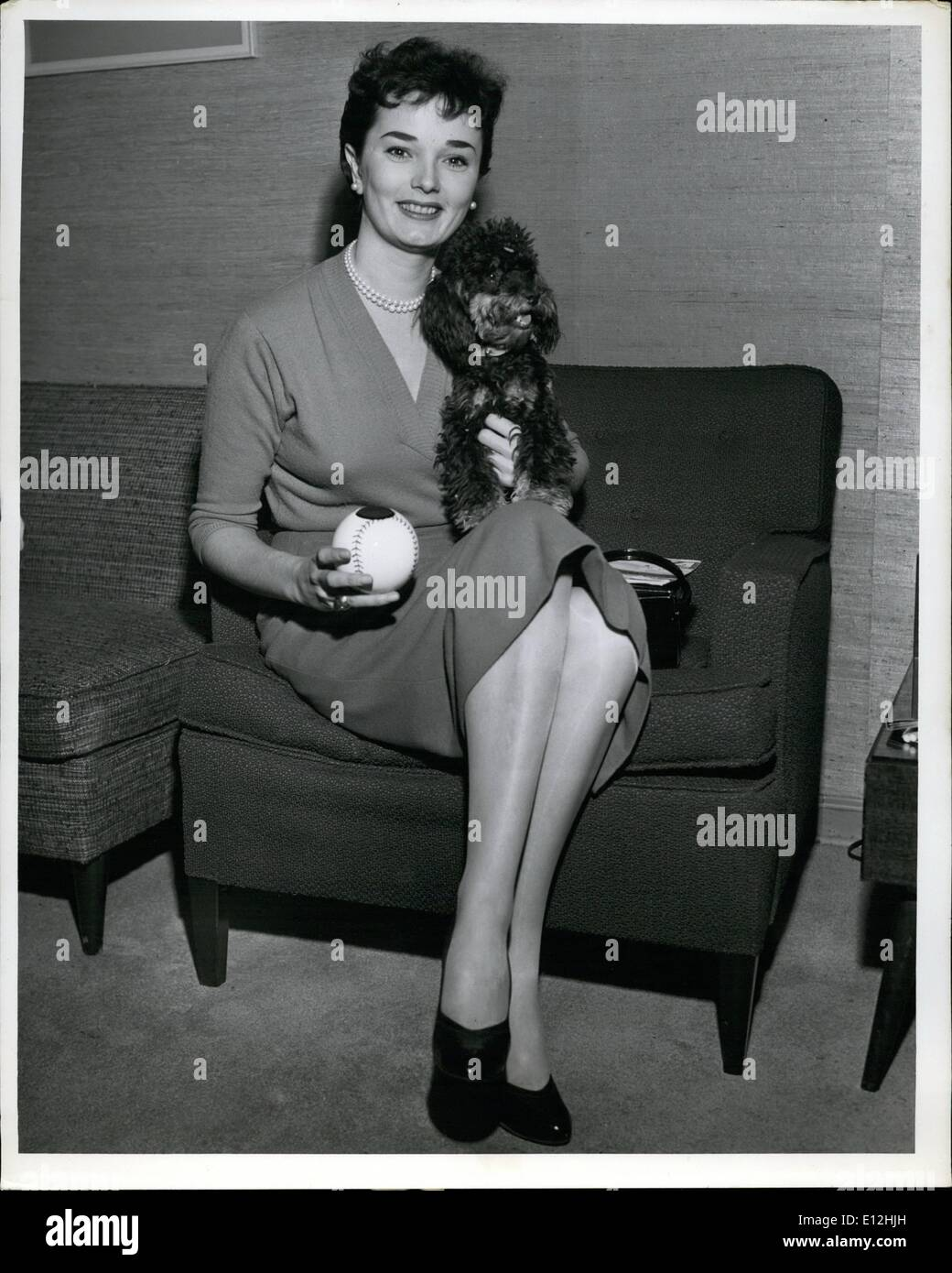 Feb. 24, 2012 - Lovely Sharon Saunders and her pet poodle, ''Pompeii'', look at a crystal ball toy to see what the future offers before they took a TWA flight to Wichita, Kansas. The pretty model and former film actress will be visiting friends and relatives. - Stock Image