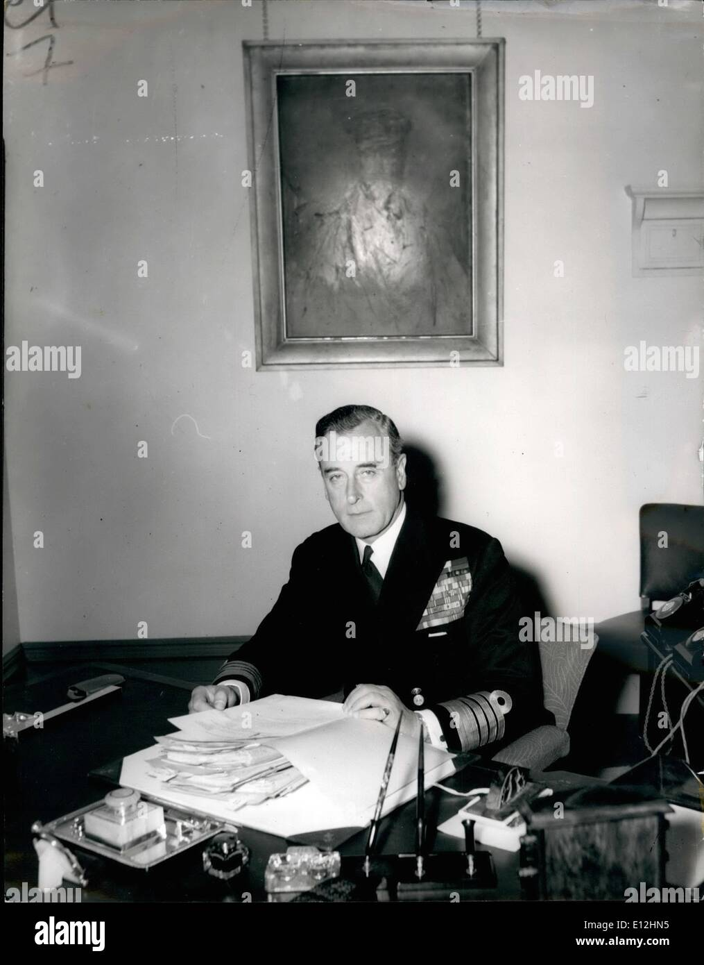 Jan. 04, 2012 - PHOTO SHOWS ADMIRAL EARL MOUNTBATTEN of Burma, pictured at his desk in his room at the Admiralty this morning. The painting in the background is of his father, Prince Louis of Battenburg, who was First Sea Lord immediately before and up to the outbreak of the 1914-18 war. - Stock Image