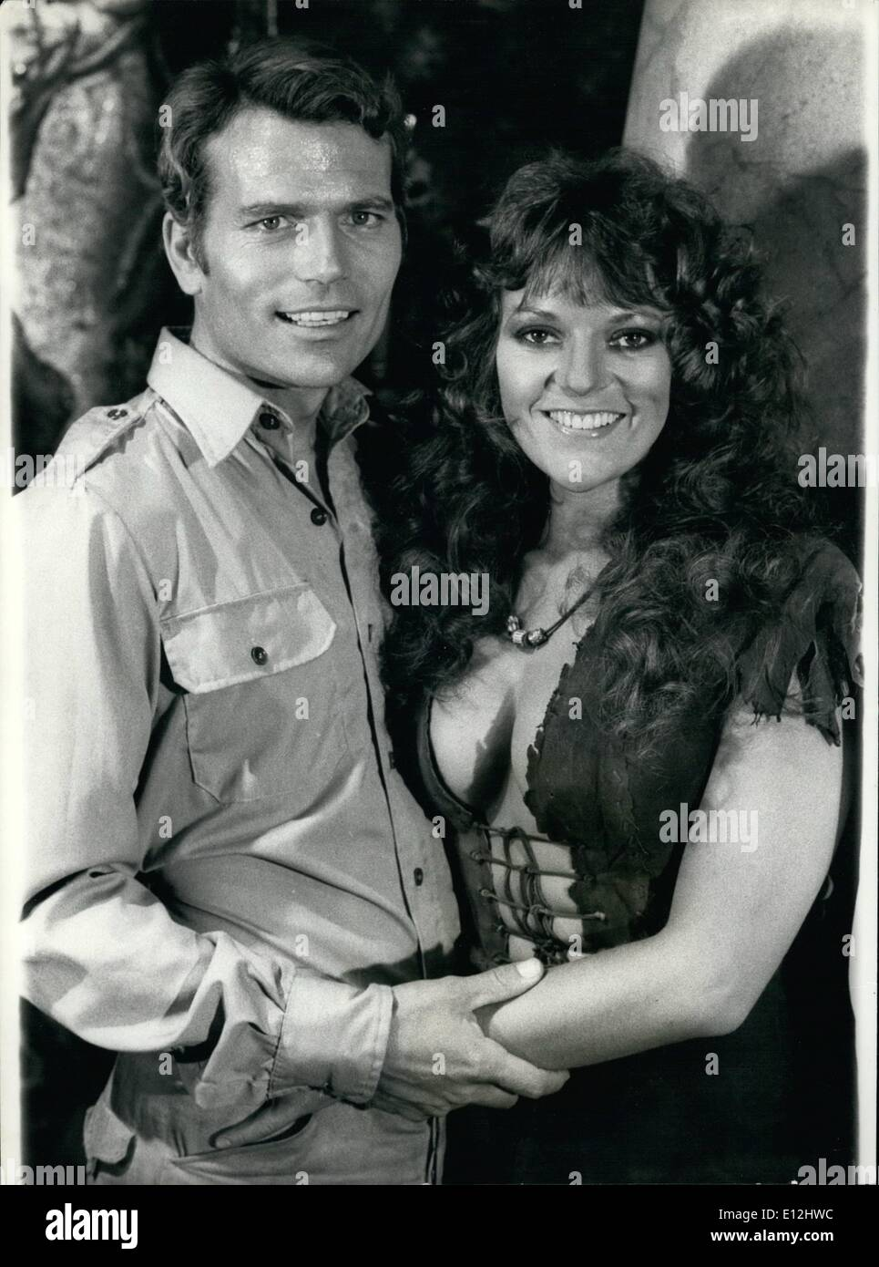 Feb. 24, 2012 - Chip off the old block.: This handsome rugged looking man photographed with the British film actress Dana Gillespie as Patrick Wayne the 37 year old son of Big John Wayne. He is in England to star in the film, ''The People That Time Forgot'' which also stars Doug McClure, and Dana Gillespie. - Stock Image