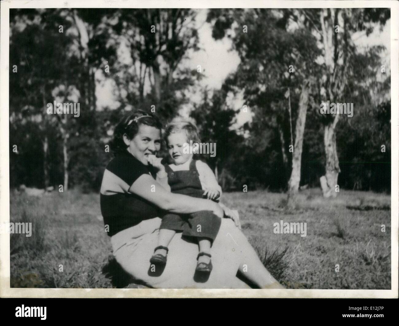 Feb. 24, 2012 - Last Wish of a German emigrant fulfilled; A wealthy Australian made it possible for a woman born in Germany to return to her home country by giving her the amount of 530 Australian pounds. Thus she was able to bring her two children to her parents - and can die in her home country. The now Mrs. Szewszik nee Mueller emigrated in 1949 to Sidney (Australia). Some months ago she fell severely ill in spite of several operations the physicians mean that she will die in a few weeks. Her mother, Mrs - Stock Image