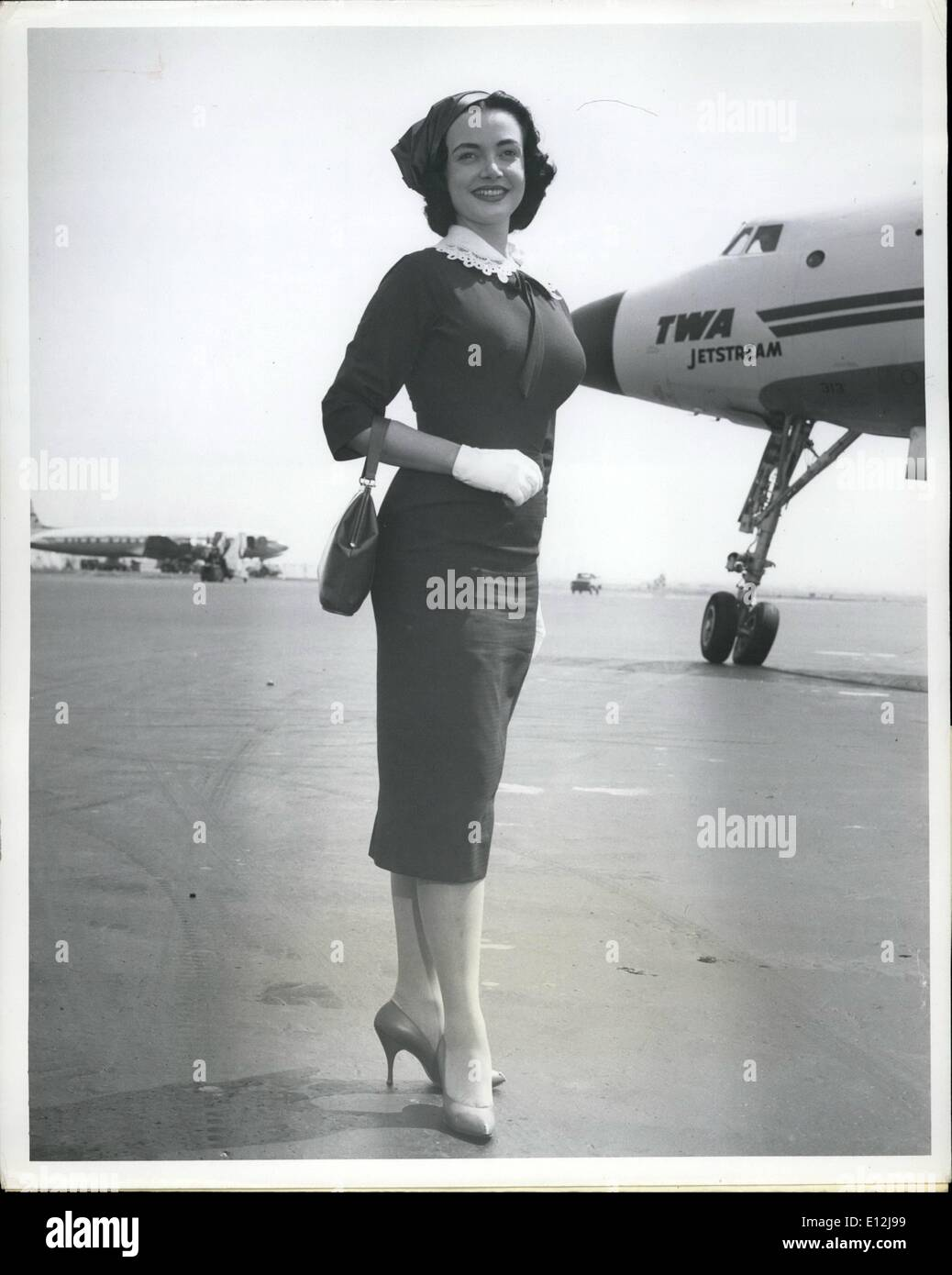 Feb. 24, 2012 - Idlewild Airport, N.Y., April 18-- Voluptuous Singer- Actress Kitty Dolan, 20, stands out Beautiful Stock Photo