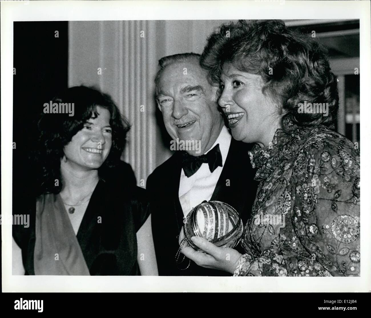 Feb. 24, 2012 - New York City - Feb. 18, 1981 - Waldorf - Astoia - The Scientists' Institue for Public Information hold a dinner-dance honoring CBS newsman Walter Cronkite. Left to Right are; Dr. Sally Ride, Astronaut(NASA Space Program), Walter Cronkite, CBS Newsman, and Beverly Sills, opera star and Mistress of Ceremonies. - Stock Image