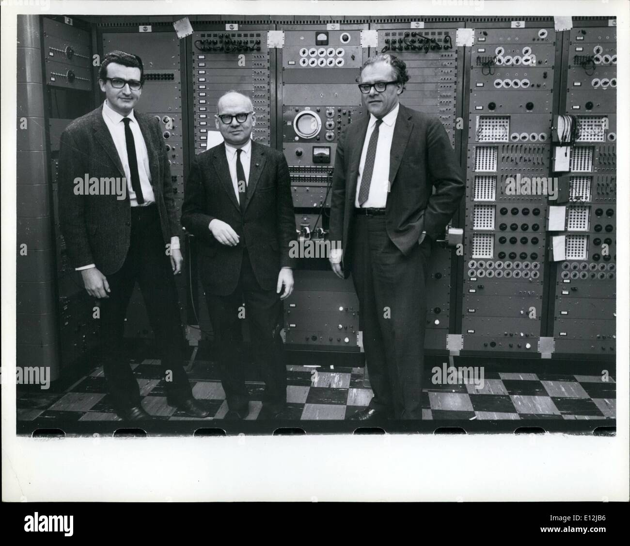 Feb. 24, 2012 - Electronic Music Center of Columbia and Princeton Universities in New York. From left to right: Argentine composer Mario Davidovsky, Milton Babbitt, American composer, Vladimir Ussachevsky, Chairman of the Columbia-Princeton Electronic Music Center. The instrument is the RCA synthesizer. - Stock Image
