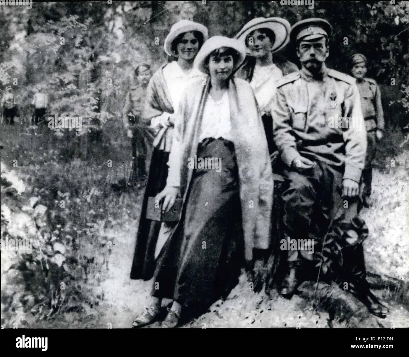Feb. 24, 2012 - THE LAST RUSSIAN CZAR, NICOLAUS 11, WITH THRE OF HIS FOUR DAUGHTERS DURING IN GINERIA AND FEW WEEKS BEFORE THE ASSASINATION. FROM LEFT TO RIGHT: MARIA ANASTASTA, OLGA AND THE CZAR, JAILERS OF THE BOLSHEVIK ARMN SEEN IN BACKGROUND. - Stock Image