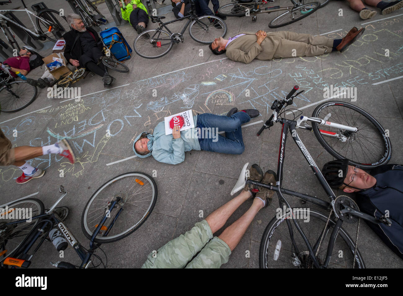 London, UK. 21st May, 2014. Jenny Jones (centre) of the Green Party joins the London cycling protest 'die-in'. Credit:  Guy Corbishley/Alamy Live News - Stock Image