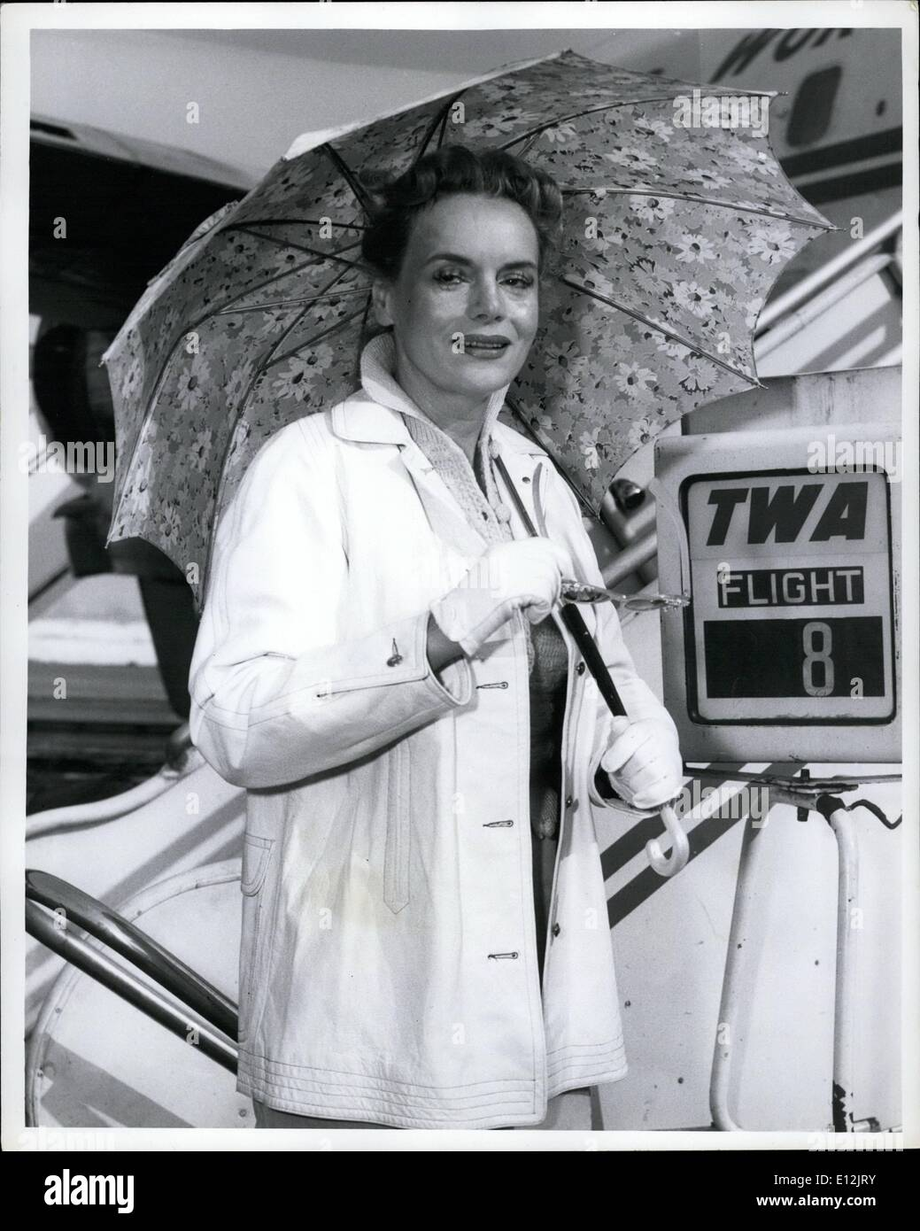 Feb. 24, 2012 - Idlewild Airport, N.Y., March 2 - Comical Marie Wilson Keeps in Character by opening her umbrella although the water was clear when she arrived via TWA from Hollywood. Marie will be with us for a week fulfilling engagements including the Ed Sullivan show tomorrow evening. She arrived with her husband Bob Fallon. - Stock Image