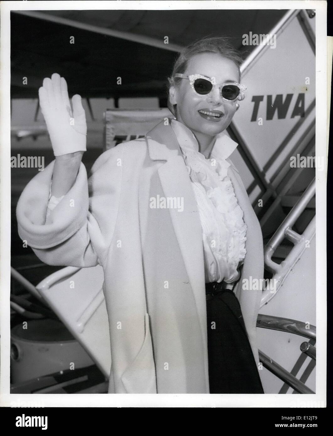 Feb. 24, 2012 - Idlewild Airport, N.Y., March 10 - Buxom Marie Wilson of the movies boards a TWA Plane here today Stock Photo