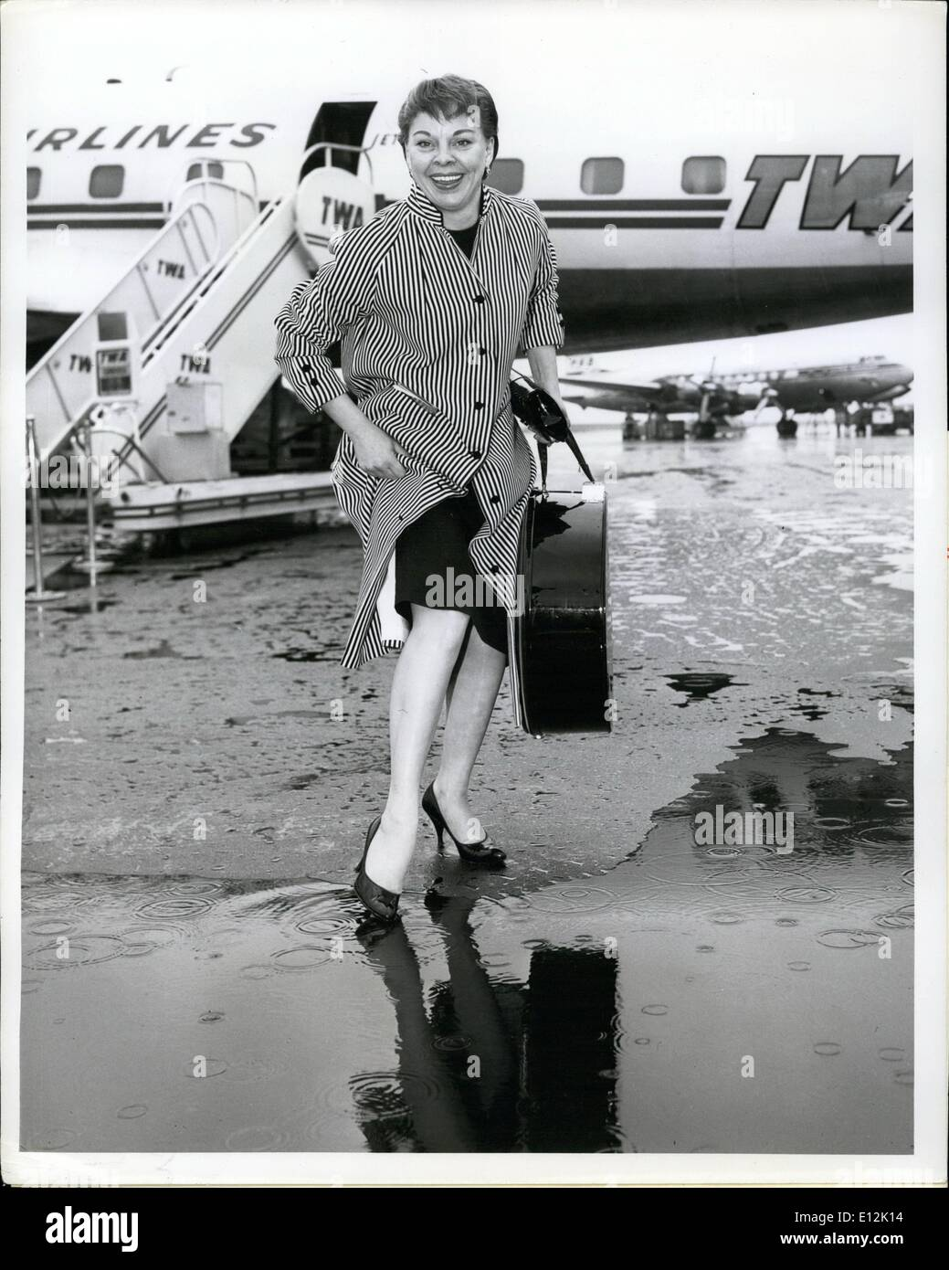 Feb. 24, 2012 - Idlewild Airport, N.Y., June 20 --- The Dancing Feet of Carol Haney are about to get wet prior to Stock Photo