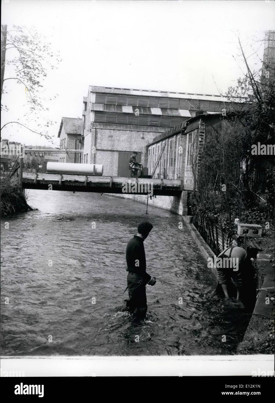 Feb. 24, 2012 - The Swift waters of the River Wyle cause the embankment to erode, and workmen are pictured constructing a brick - Stock Image
