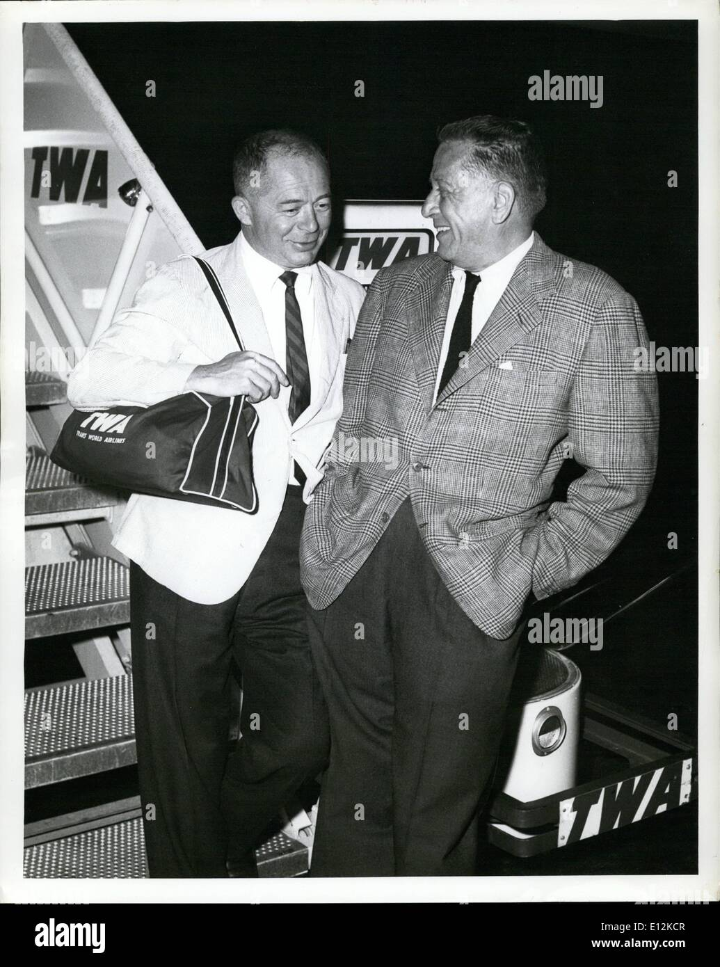 Feb. 24, 2012 - Idlewild Airport, N.Y., -- Leland Hayward, right and Billy wilder, pause on Completion of the first Stock Photo