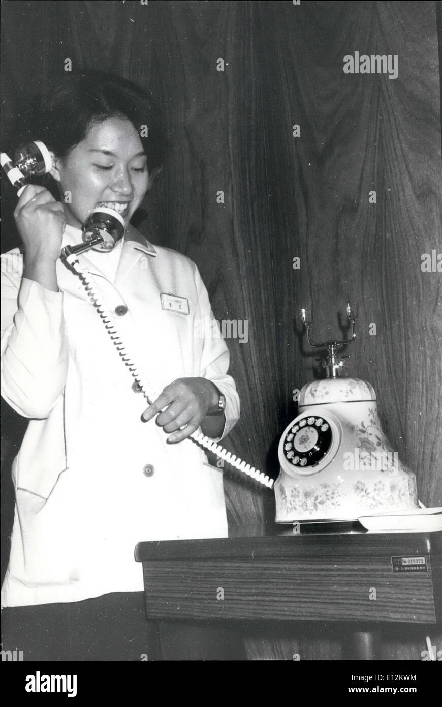 Feb. 24, 2012 - Japanese China Telephones,: One of the new type decorative telephones made of unbreakable china, being used by a Tokyo girl. The Telephones are on sale for Yen 80,000 each (£ 50.00) - Stock Image