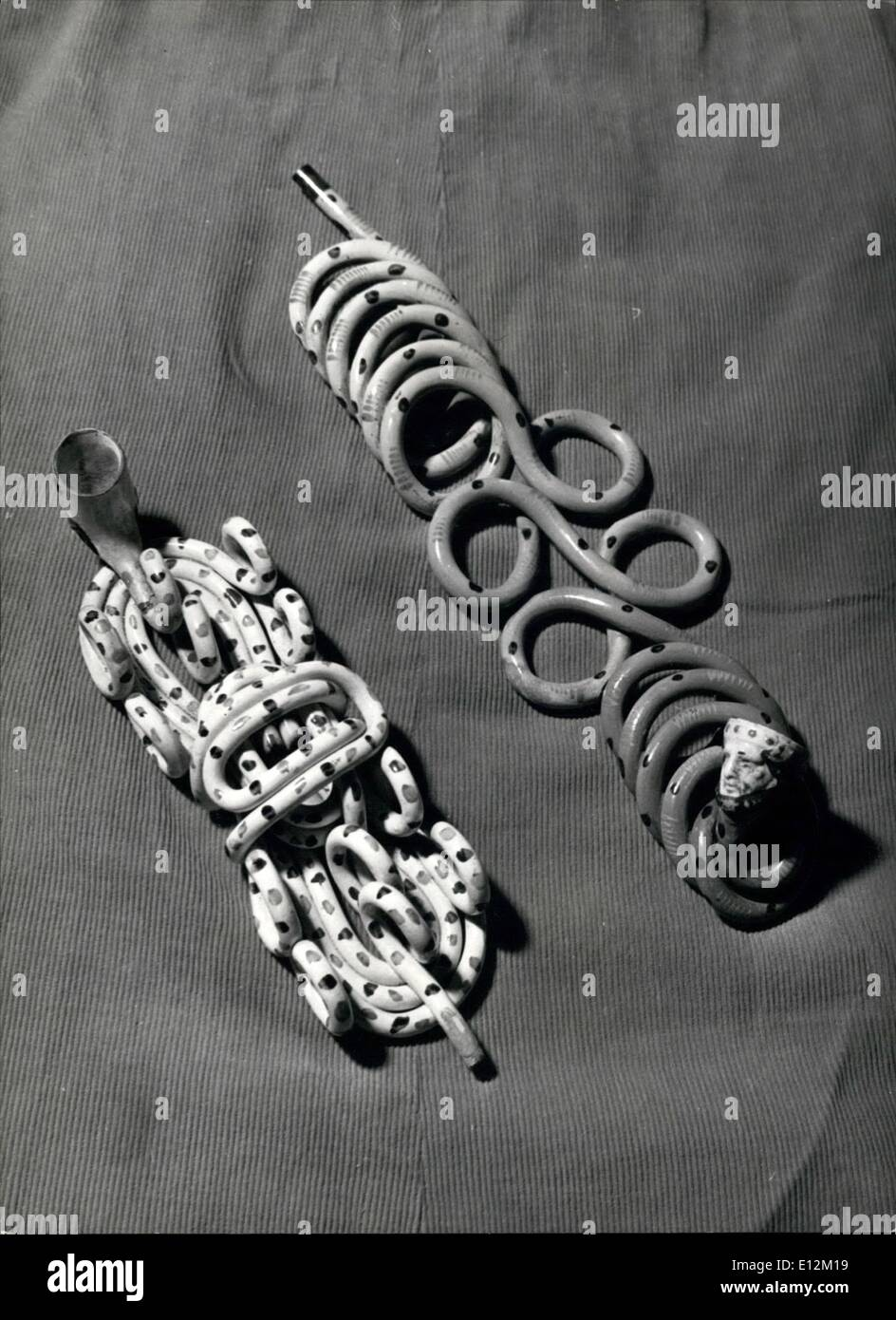 Feb. 24, 2012 - Puzzle Picture:Yes, those are pipes: In Trevor Dist n's collect on are these two fine and valuable examples of a wire Staffordshire clay pipe dated 1700. the coiled clay pipe stretches between 10-12 feet. - Stock Image