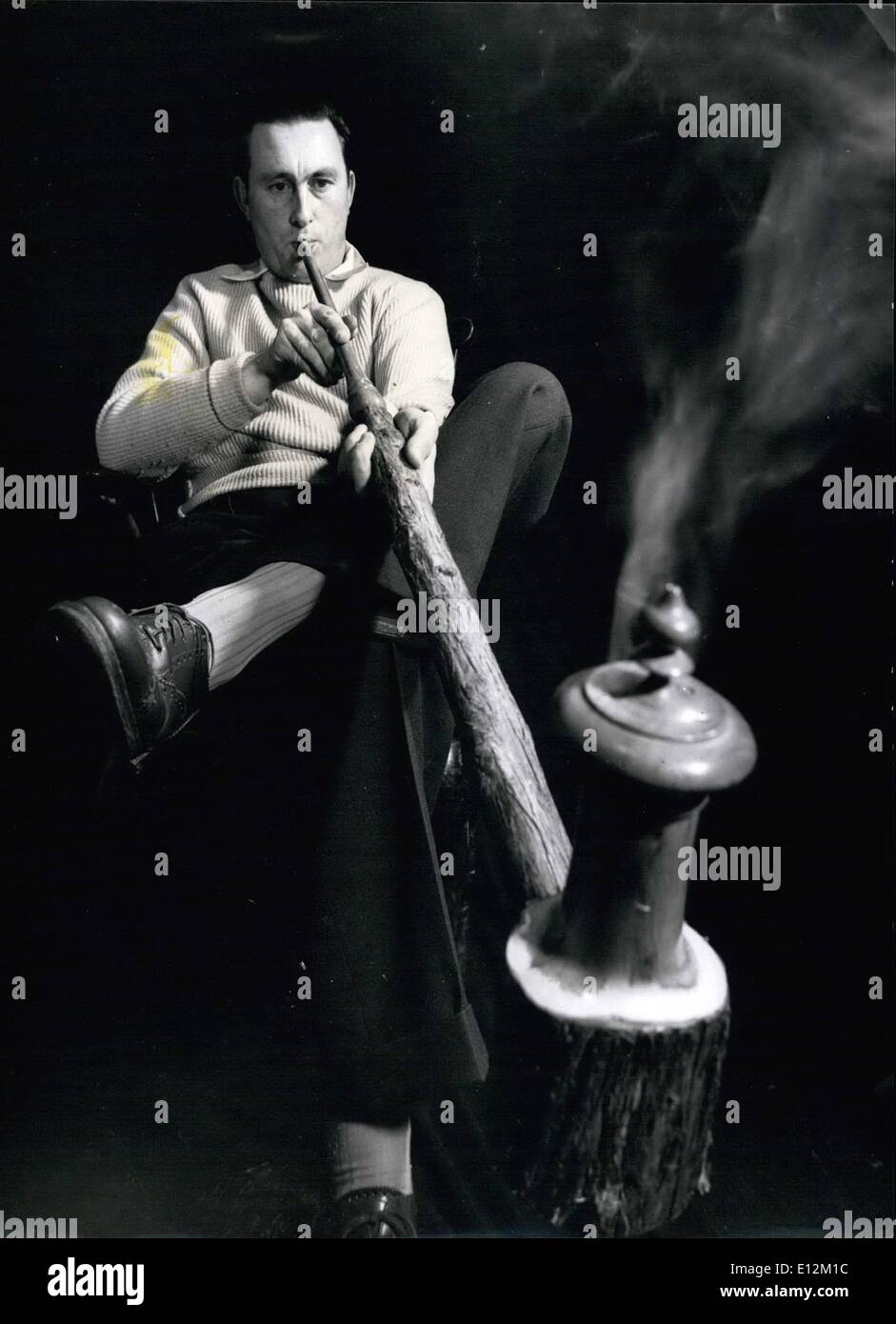 Feb. 24, 2012 - Mr Barton and one of this four hundred pipes: Mr Barton sooes his Austrian novelty pipe which holds three ounces of tobacco and has a stem six feet long. - Stock Image