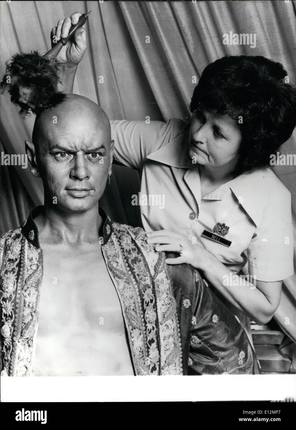 Feb. 24, 2012 - Yul gets the brush Off: Yul Brynner gets his famous bald head dusted off by a houseproud maid. Or so it would seem. Fact is, the figure is only an incredible likeness of the super star. It is a major attraction at the Stars Hall of Fame wax museum near Orlando, Florida. - Stock Image