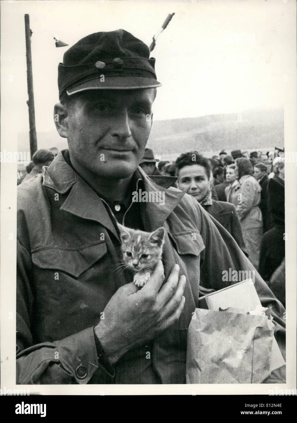 Feb. 24, 2012 - Returnees. A small cat from Stalingrad Camp brought along to Germany. In spite of barbed wire, hunger and cold, our returnees never forgot loving the animals. Friedrich Rath from Cologne took this small cat with himself over the borderline to Germany. - Stock Image