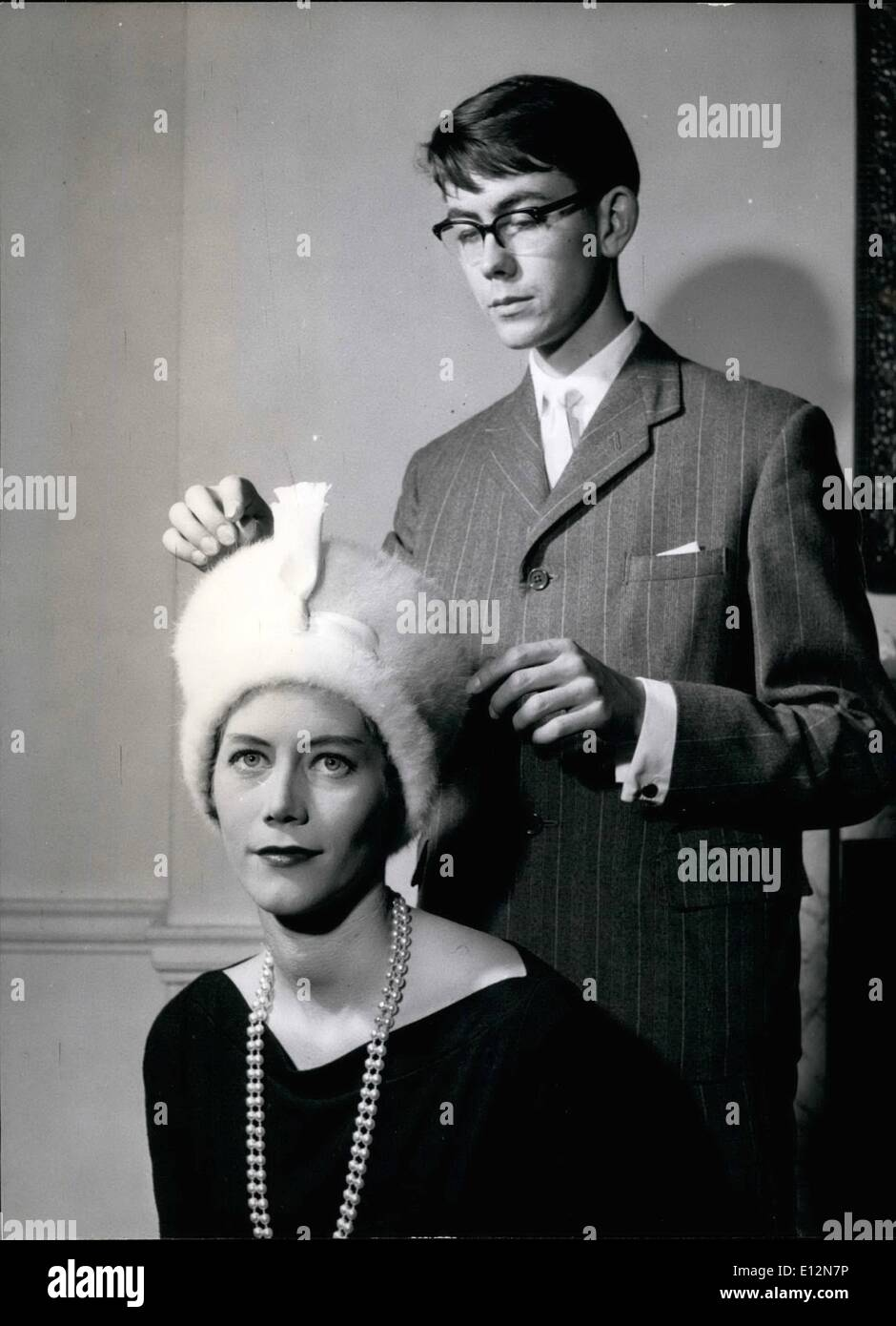 Feb. 24, 2012 - The milliner sees his hat is on correctly: Graham Smith with a model wearing a Hussar-styled hat. - Stock Image