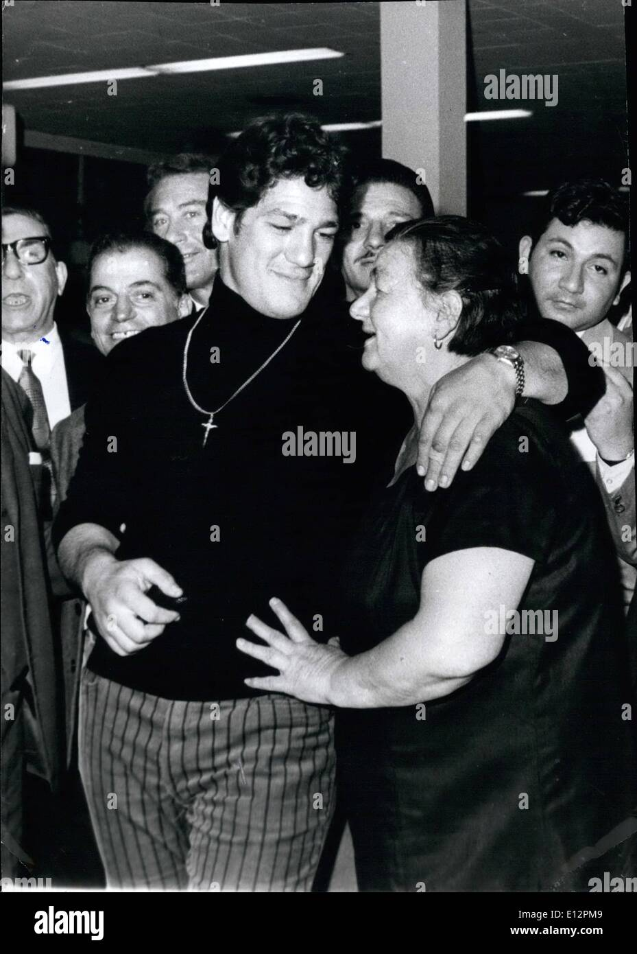 Feb. 24, 2012 - The tragic end of an Argentine Heavyweight Boxer in United States. Buenos Aires, May 25th 1976. This is Oscar Natalio Bonavena, one of the outstanding Argentine boxers in a recent picture showing him after returning from one of his matches and showing him with his mother always so proud on her son. And now all has finished due to the fact. Bonavena was assasinated near Reno, Nevada under gangster like circumstances. - Bonavena was the 7th ranking boxer in the world category. - Stock Image