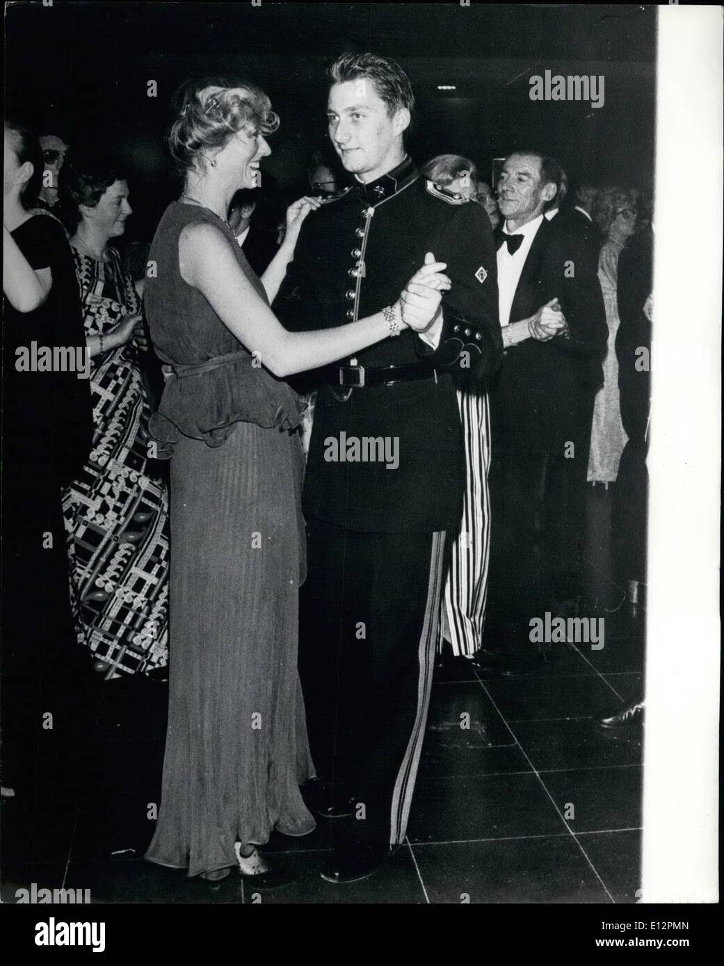 Feb. 24, 2012 - His First Ball Accompanied by his parents, Albert and Paola, Prince Phillipe of Belgium atended his first ball at the SaloNon English Contentdu Haysel, at the Royal Military School in Brussels, where he is training to be an officer. Photo Shows: Prince Phillipe during the dance, with one of his mant partners. - Stock Image