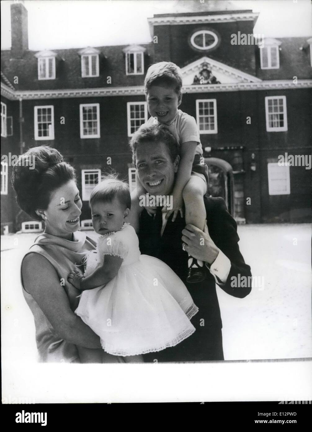 Feb. 24, 2012 - A new picture of Princess Margaret, the Earl of Snowdon and their children: A happy study of H.R.H. Princess Margaret with her husband the Earl of Snowdon and their two children taken in the Clock Court of Kensington Palace, London. Lady Sarah who is wearing a dress of white organdie, trimmed with white lace, was born on May 1st. 1964. Lord Linley (on his father's shoulders) was born on November 3rd,1961. - Stock Image