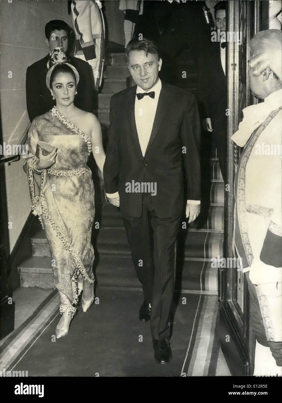 Feb. 25, 2012 - All lady guests wore trousers at Lido Premiere: All lady guests attending the Premiere of the Lido New show wore trousers instead of traditional evening dress, this was an unusual ''stunt'' imagined by the lido directors and an additional attraction of the glamorous show. Liz Taylor as an exception did not wear trousers but a gorgeous sari. She is seen accompanied by Richard Burton. - Stock Image