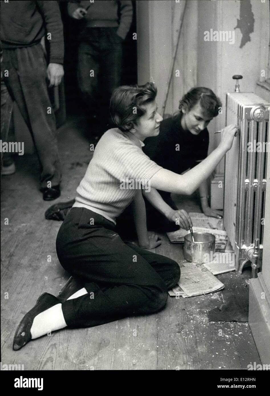 Feb. 25, 2012 - Operation Donnington Hall: Radiator Appeal: Students Joan Durbar and Celine Taylor put a coat of paint on a radiator which had not been used since before the war. - Stock Image