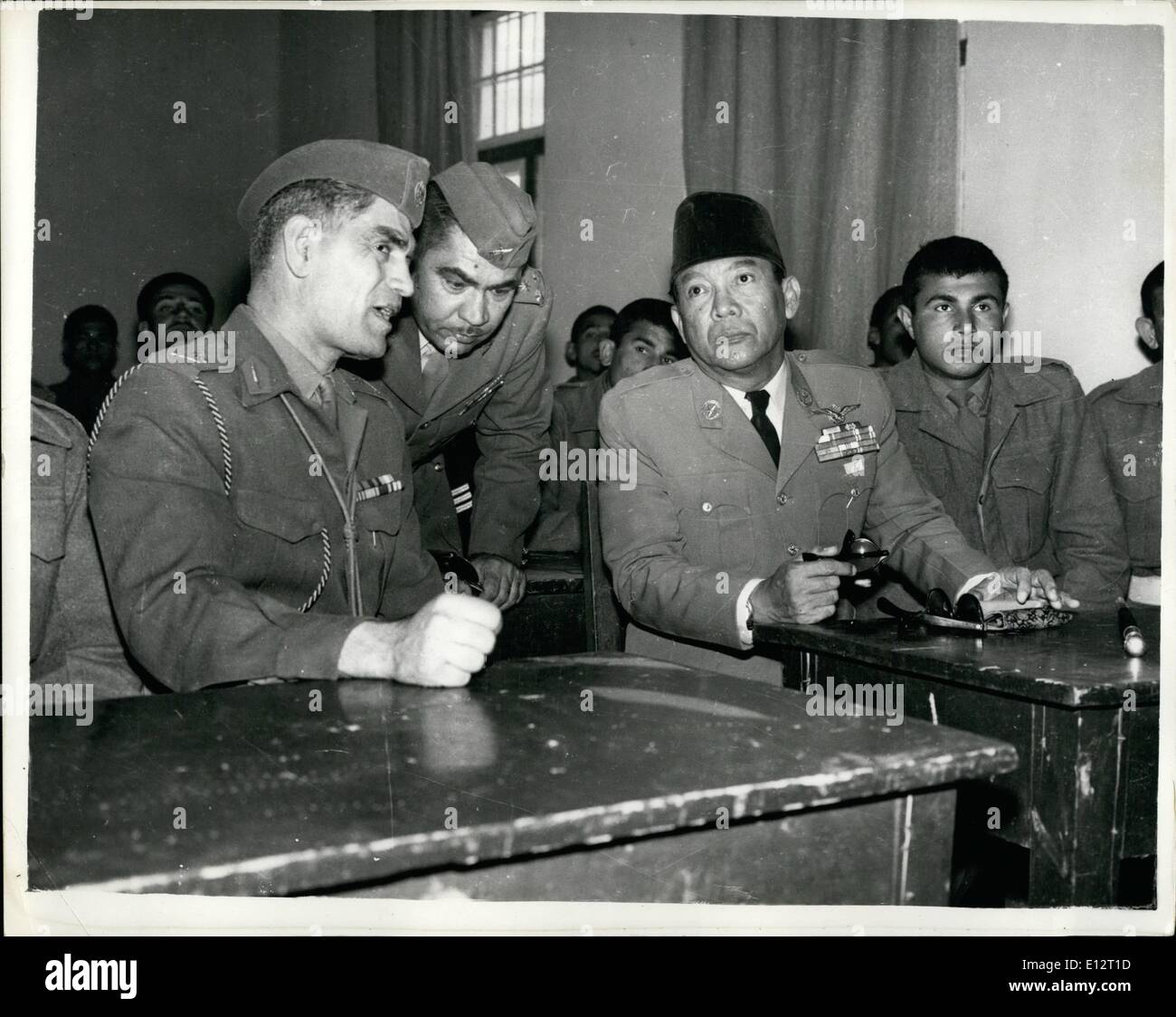 Feb. 24, 2012 - Two Men with Peace or War on Their Minds This Weekend Seated together in an Army College in Irak are two dictators of this troublous age. General Kassem of Irak, whose ambition and declared aim is the conquest of oil rich British protected Kuwait, and President Sukarno of Indonesia who has just announced that Western Irian (as he call the remaining part of the former Dutch East Indies empire) is his and will if necessary be taken by his forces. This hitherto unpublished picture was taken when the two heads of state met in the Iraki capital. - Stock Image