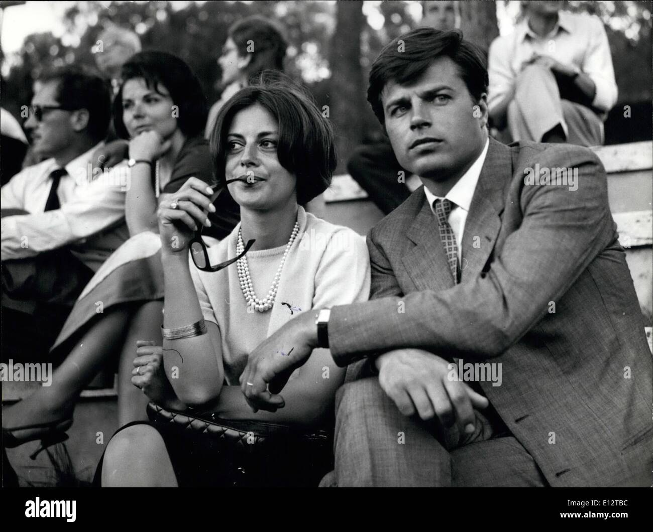 Feb. 24, 2012 - Rome, May 9th 1964. Anna Maria Ferrero, the Italian actress who married one year ago French actor Jean Sorel seen today with her husband at the Tennis Championship at Foro Italico. The couple who live during the winter time in Paris are in Rome for a holiday and also for film conference. - Stock Image