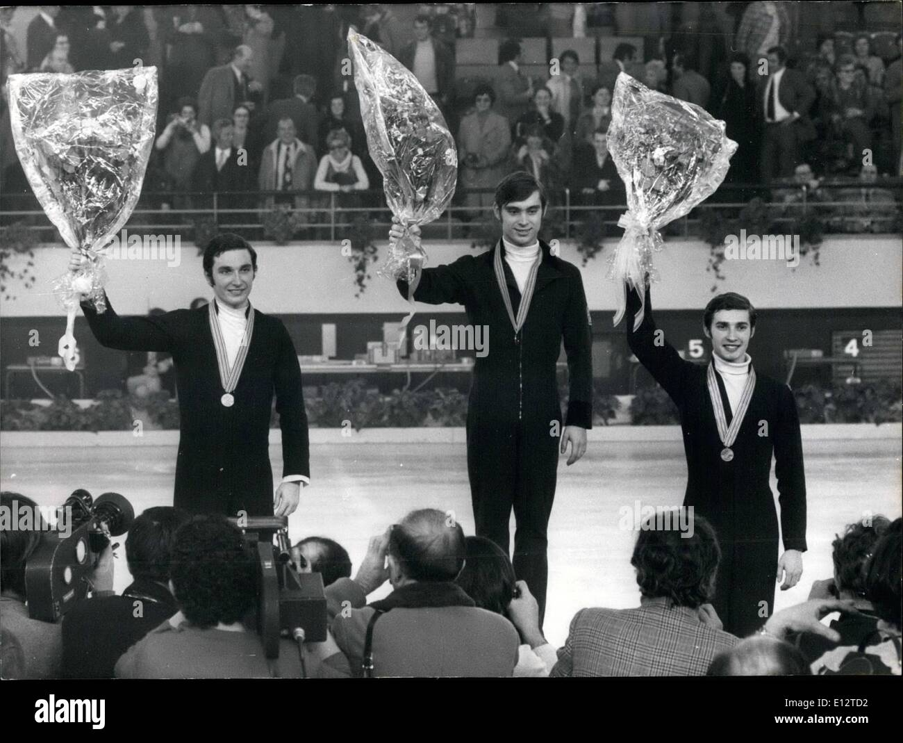 Feb. 24, 2012 - CZECH SKATER ONDREJ NEPELA WON THE FINALS OF THE WORLD FIGURE SKATING CHAMPIONSHIP HELD IN LYON, FRANCE. FRENCHMAN PATRICK PERA AND RUSSIAN SERGHEI TCHETVERU- . .IN CAME OUT SECOND AND THIRD. OPS ON THE ROSTRUM FROM LEFT TO RIGHT: PATRICK PERA ONDREJ NEPELA AND SERGHEI TCHETVRUKH. - Stock Image