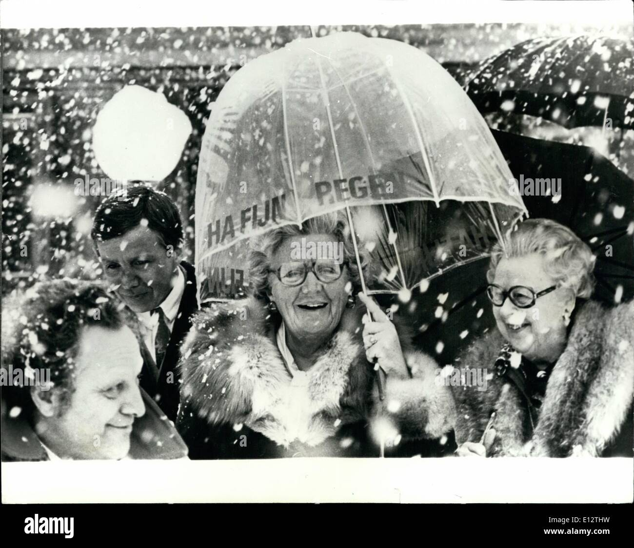 Feb. 24, 2012 - laughing in the snow.: Queen Juliana of the Netherlands opened a Psychiatric center at Oegstgeest, a village near the Haigh. Photo shows Queen Juliana seen walking in a snowstorm outside the center with ''Fine Rain' printed on the umbrella. - Stock Image