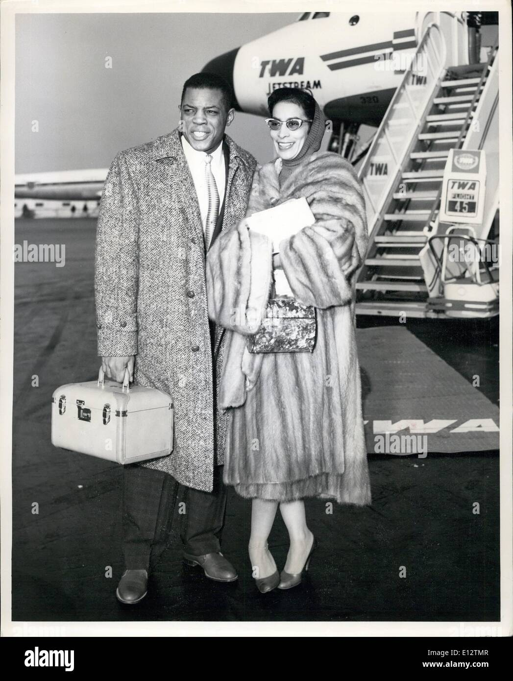 Feb. 24, 2012 - Idlewild Airport, N.Y., Jan. 3 - The ''Say Hey'' Kid, Willie Kays, Star Outfielder Of The Giants, And His Wife Prepare To Board A TWA Jetstream Flight To San Francisco Where They Will Make Their New Home. The 1958 Baseball Season Signifies The First Year That California Will Enjoy National Baseball Representation. - Stock Image