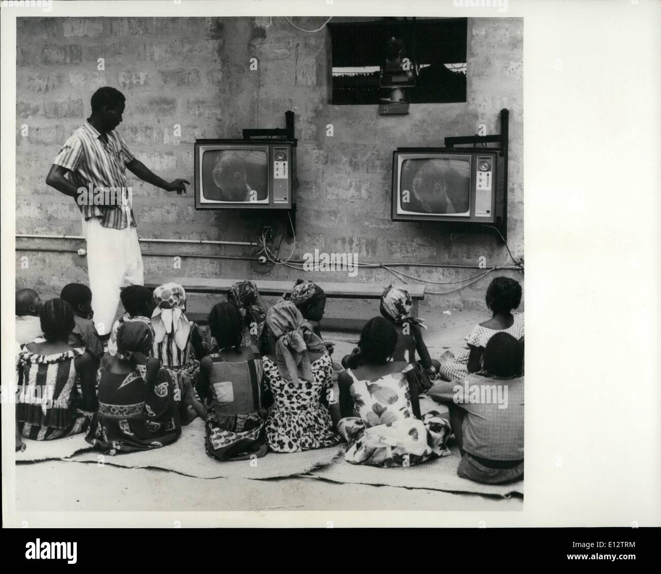 Feb. 25, 2012 - Closed Circuit Educational Television in Niger Niamey, Niger, 1965. ''Operation Tele Niger'', an experiment in television teaching, began in Niger in 1964 with two experimental classes 70 six and seven year old pupils. It was found after two years that the children had learned at least as much as they would have done in a traditional school. Presently, some 800 children in 20 villages in the region of Niamey, the Capital of Niger, are learning to read and write from these special television programmes - Stock Image