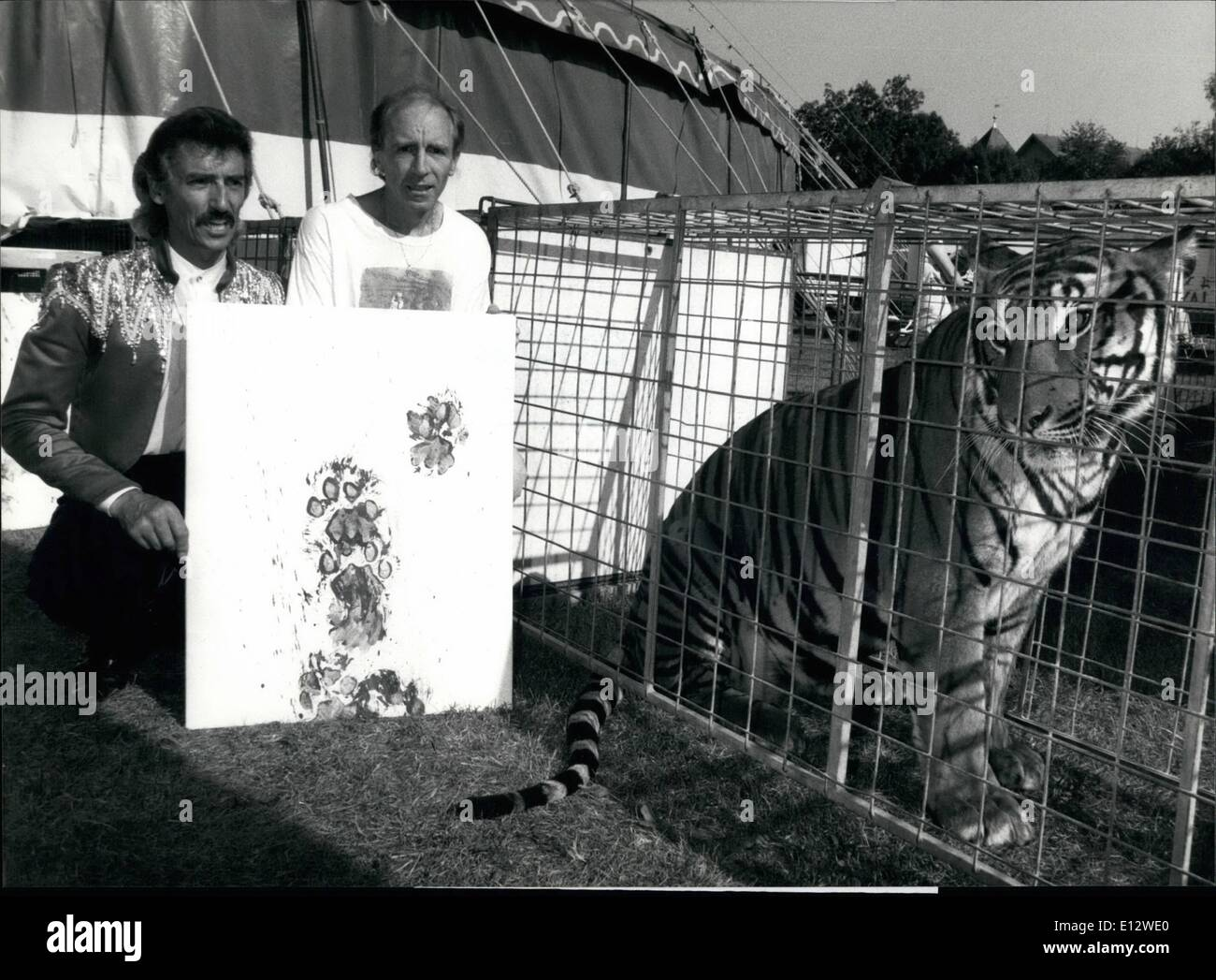Feb. 25, 2012 - Foot Art : Paintings by tigers. Animal trainer Jerry Wegmann (left) and artist Rene Gubelmann from Dietikon near Zurich display a painting created by tiger Sonny . Tigers, panthers, and pumas step over a white canvas with coloured paws and leave behind an original and individual foot art painting. - Stock Image