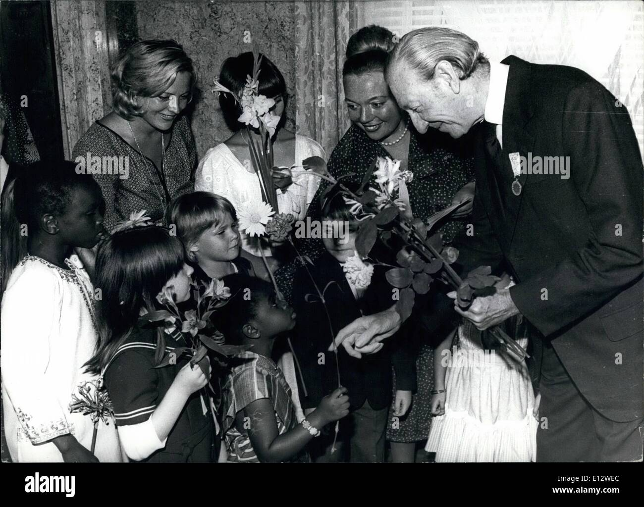 Feb. 25, 2012 - After the ceremony Kurt Waldheim talks to children. - Stock Image