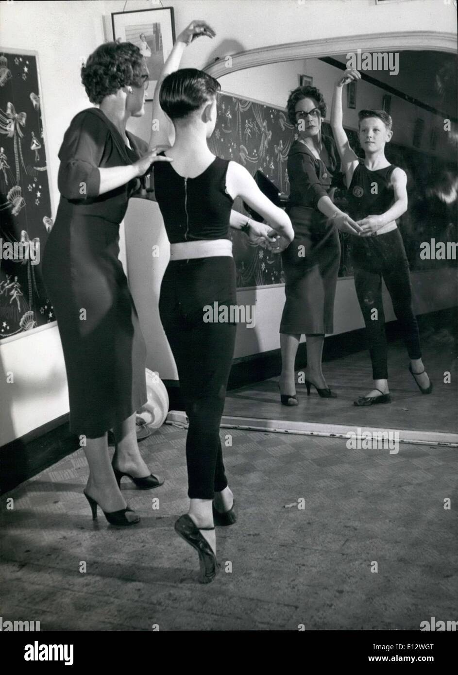 Feb. 25, 2012 - John practices ballet before the mirror assisted by Liss Dora Crowley who has been teaching him for the past 21/2 years. - Stock Image
