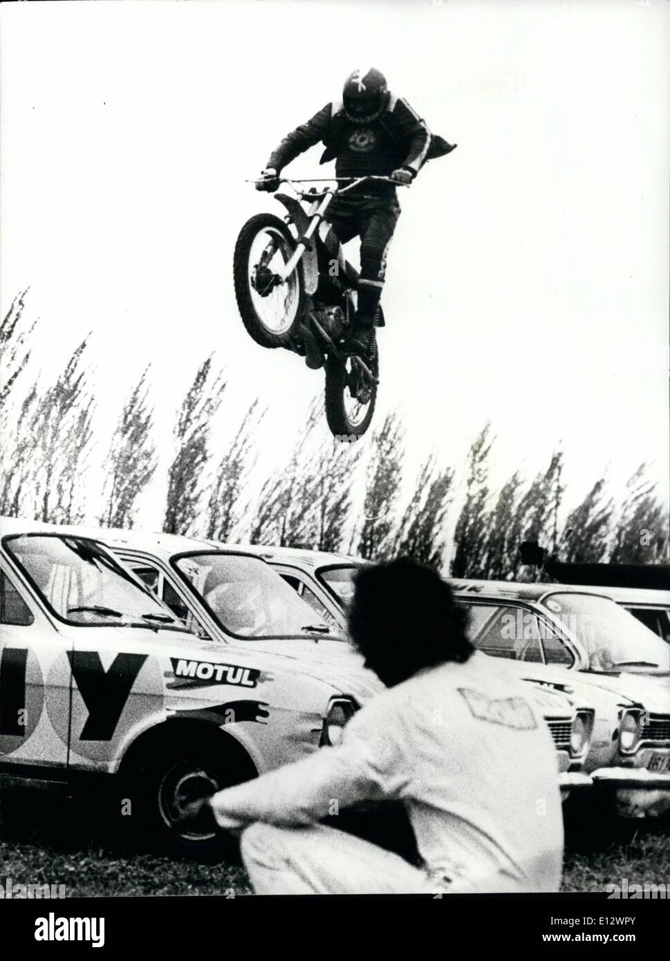 Feb. 26, 2012 - Up and Over; Jean Claude Galliot flies through the air on a motor cycle over a line up of seven cars at Coigneres, near Paris, where he and other French dare-devils, led by Jean Sunny, performing hair-raising stunts, watched by breathless spectators. - Stock Image