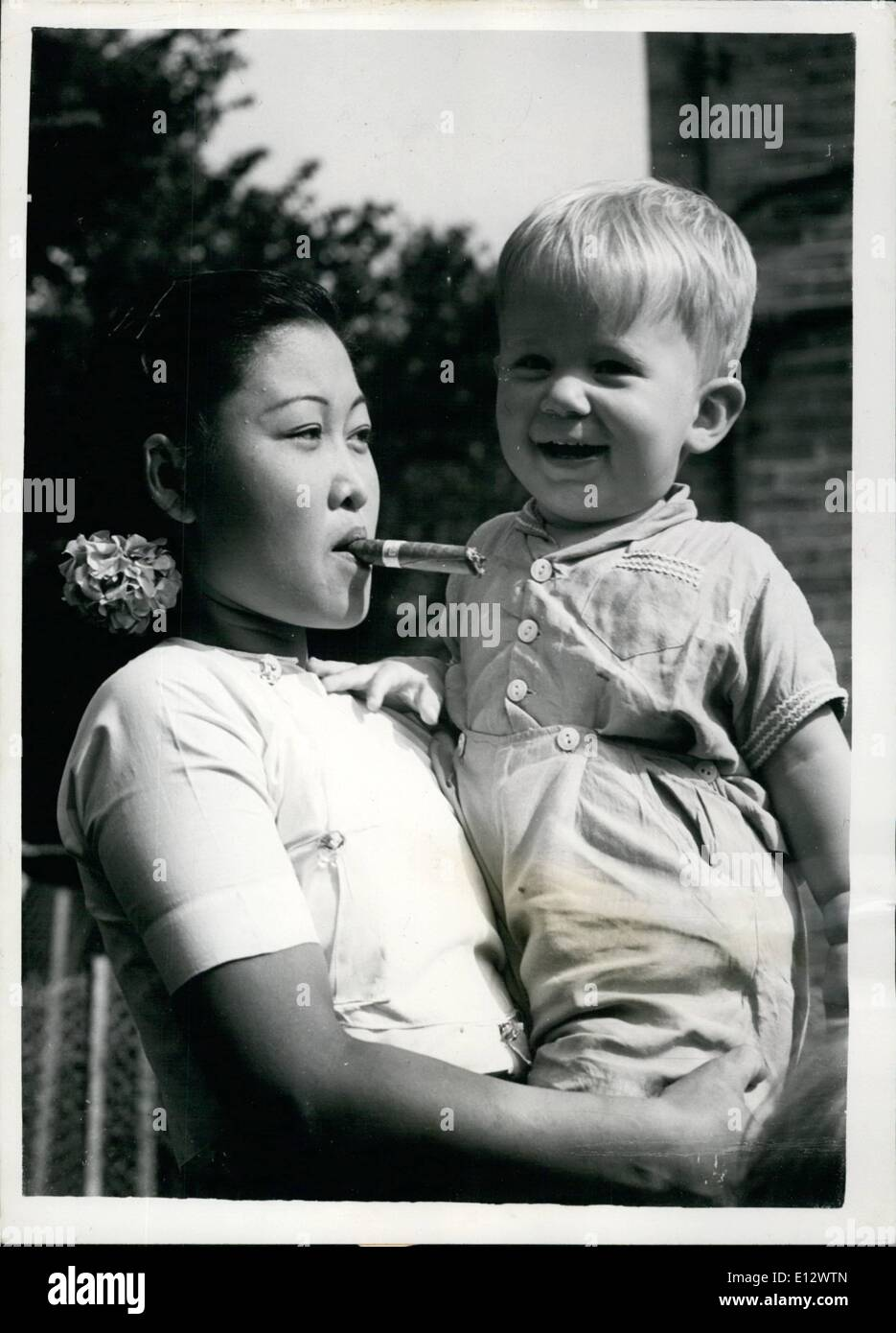 Feb. 26, 2012 - She Rations Herself to One Hundred Cheroots a Month... The ''Nanny'' from Rangoon... Although she is only a very small woman (four feet six inches in height) Mrs. Esther Chit Win - a 24 year old) has a problem to solve... Mrs. Esther Chit Win came to this country to act as ''Nanny'' to the children of Mr. and Mrs. E.W. Drown of Mill Lane, Shoreham, Sussex - for a year.. - Stock Image