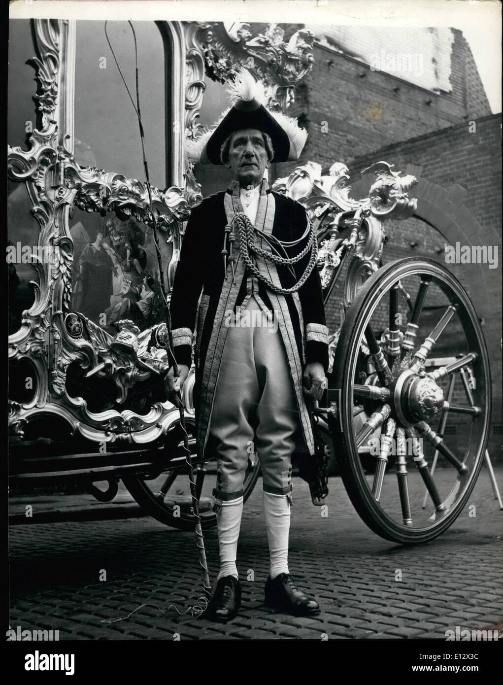 Feb. 26, 2012 - Lord Mayor's Coachman Prepares for the Big Day. The man with the trickiest job in the Lord Mayor's Show is 52 year old Mr. Henry Hawkins, driver of the Lord Mayor's coach. Mr. Hawkins is a skilled man with horses and he has to be to control the six dray horses which pull the 3 tons 16 cwts coach, for the coach has no brakes. The coach was built about 1757 and at the time the Alderman were called upon to pay 0 each and the Lord Mayor 00. The panels on the body of the coach are the work of the Florentine painter, Giovanni Battista Cipriani - Stock Image