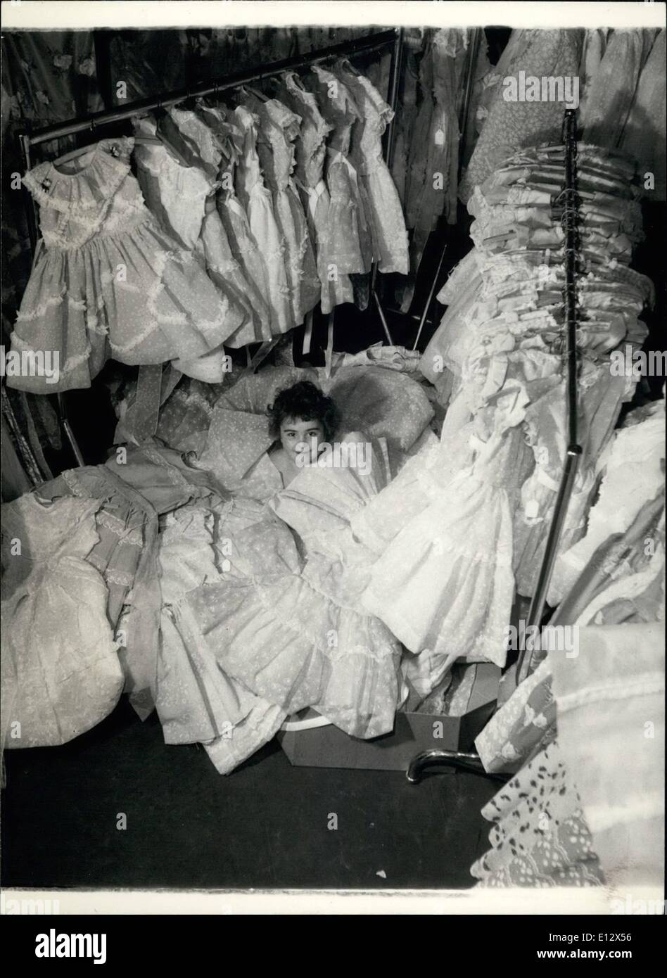 Feb. 26, 2012 - Little Annette has nearly disappeared beneath an avalanche of lace and flounces. She's going to have a job picking her party dress from all these. - Stock Image