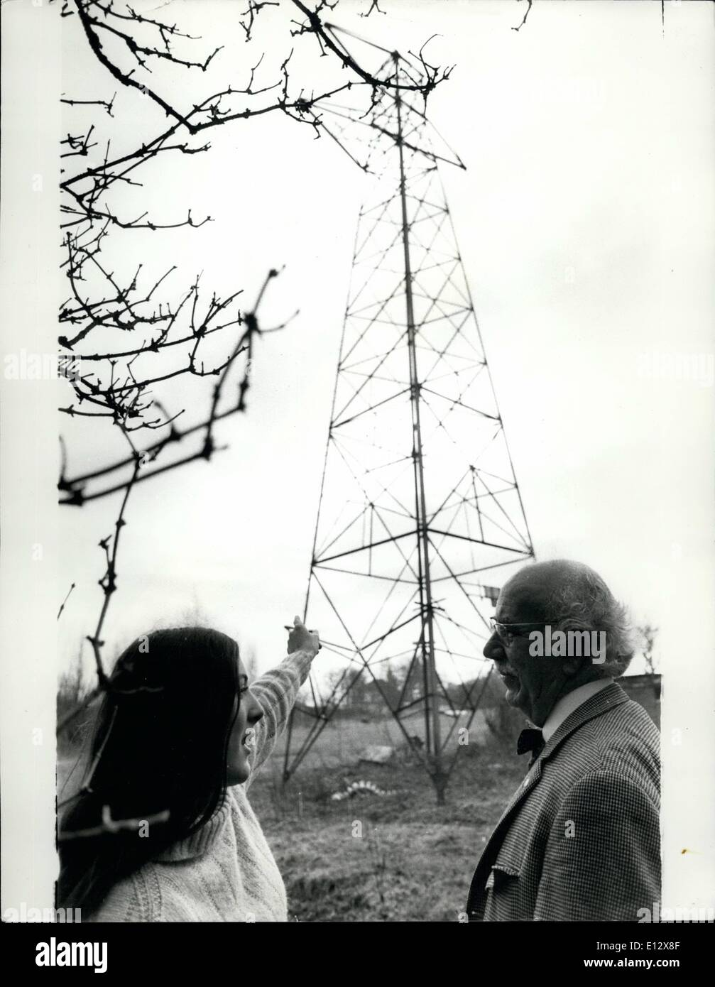 Feb. 25, 2012 - Ian Marr and his daughter Celie disuss the Pylon. - Stock Image