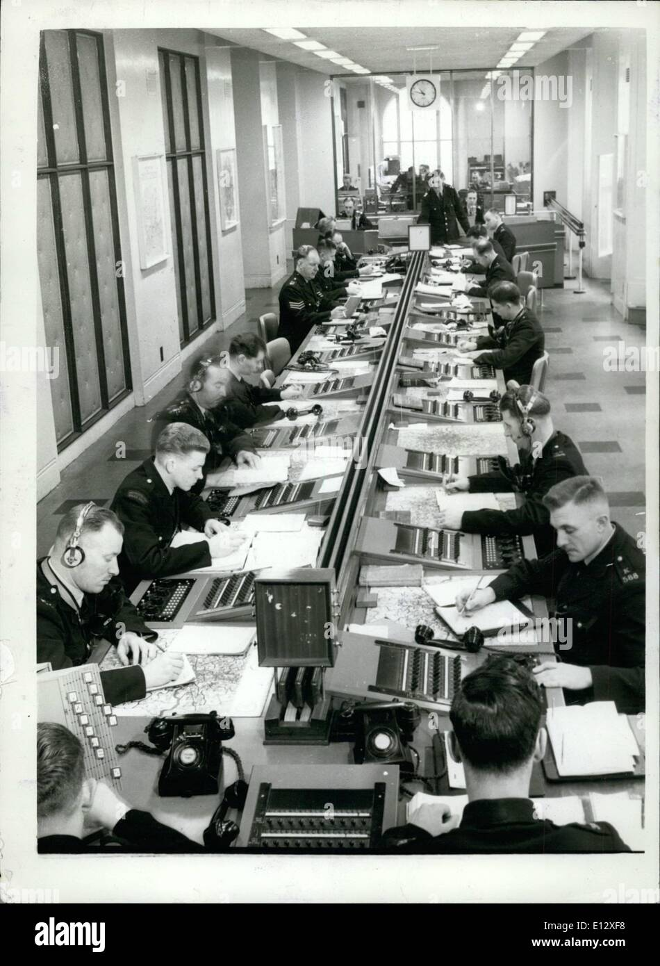 Feb. 25, 2012 - Nerve Centre: In the background telephone operators deal with enquiries, urgent or otherwise; logists and results;in the foreground, operators in communication with squad cars and other stations. - Stock Image