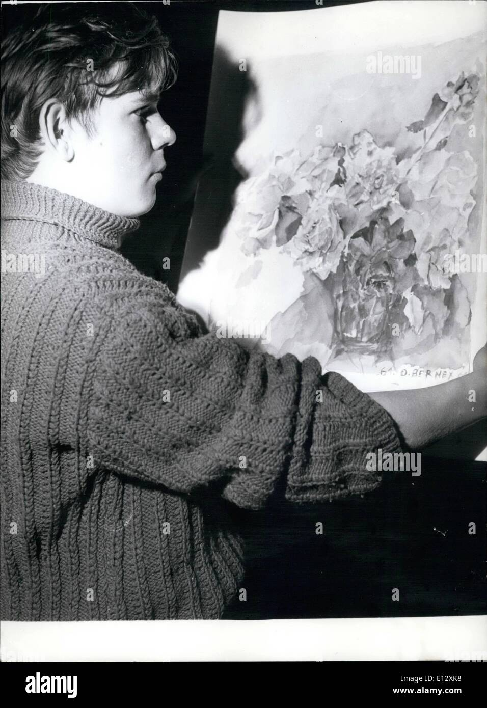 Feb. 26, 2012 - Fifteen Year Old Painter Exhibits in Paris. A left bank art gallery is now showing the painting done by a fifteen year old painter Olivier Bernex. OPS: The Youthful artist pictured before one of his paintings. - Stock Image