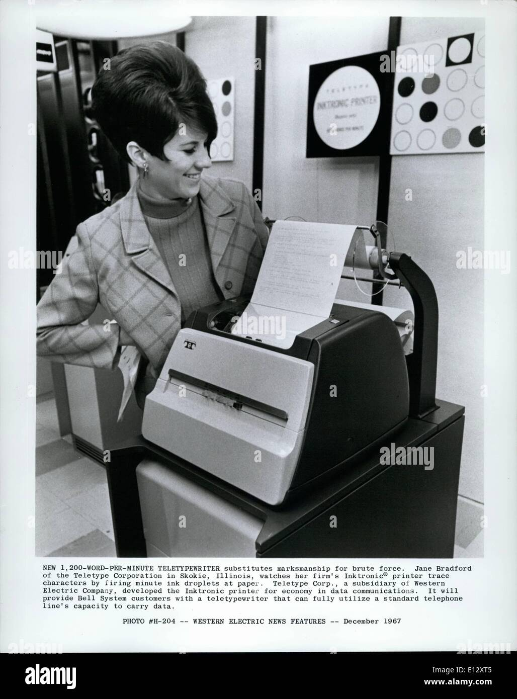 Feb. 25, 2012 - New 1-200 Word per minute teletypewriter substitutes marksmanship for brute force. Jane Bradford of the teletype corporation in Skokie, Illinois, watches her firm's Inktronic printer trace character by firing minute ink droplets at paper. Teletype Corp., a subsidiary of Western Electric Company, developed the Inktronic printer for economy in data communications. It will provide Bell Systems customers with a teletypewriter that can fully utilize a standard telephone lines capacity to carry data. - Stock Image