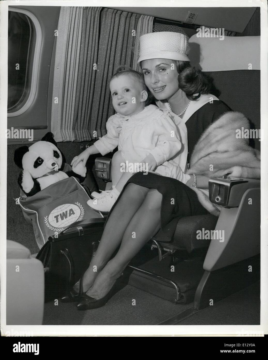 Feb. 26, 2012 - Idlewild Airport, N.Y., June 23 - Seventeen-Month Old Cutie Elizabeth Stack Reaches For Her Panda Traveling Friend While Sitting On Mommy's Lap. ''Mommy'' Happens To Be The Lovely Rosemarie Bow, Actress-Wife Of Screen Star Robert Stack. Mother And Daughter Are On Their Way To Madrid, Via A TWA Jetstream, To Join Bor Who Is On Location There. Rosemarie Recently Gave Birth To A Son. - Stock Image