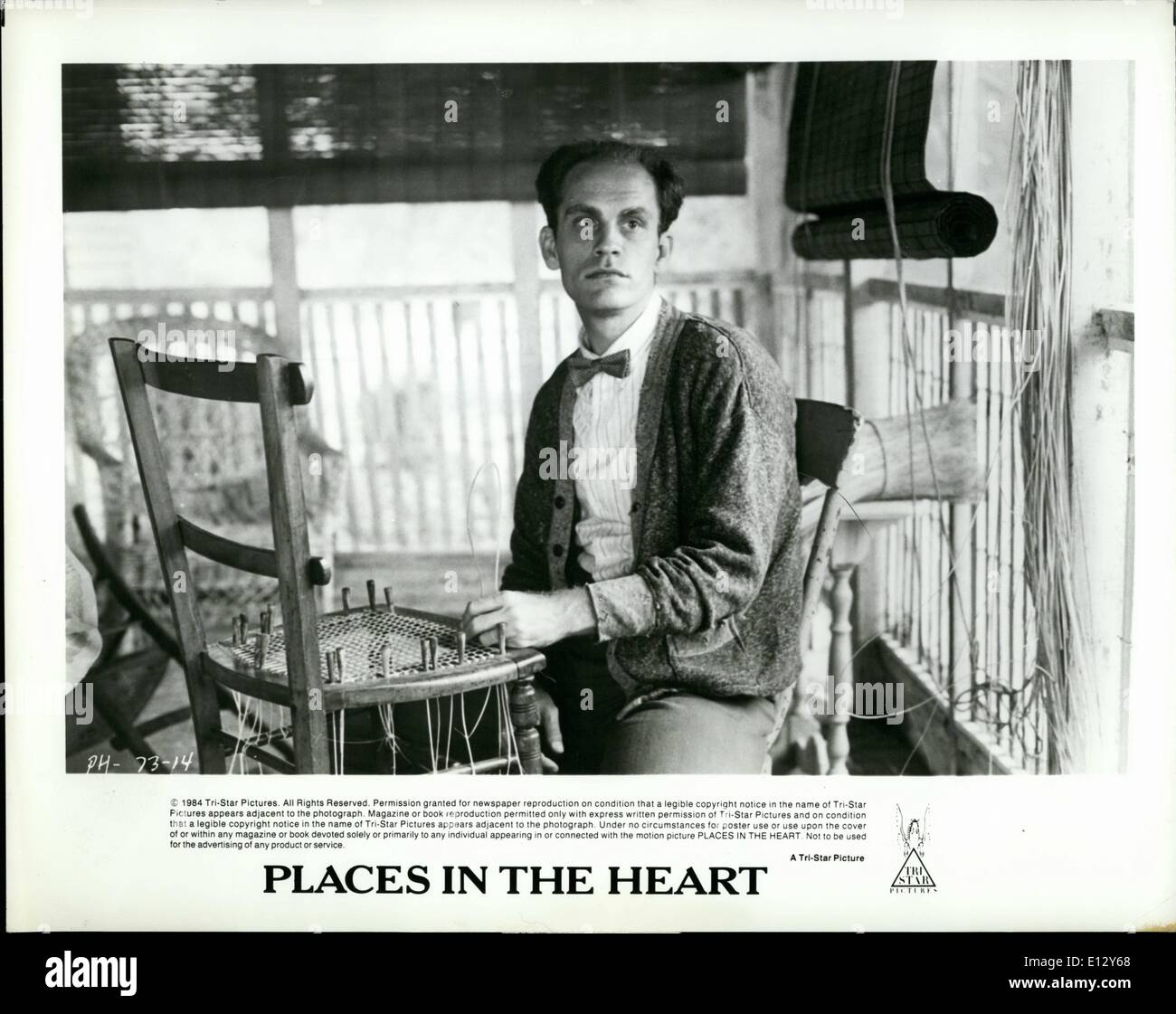 Feb. 25, 2012 - John Malkovich as Mr. Will, a blind World War I veteran, canes chairs as occupational theraphy and way to earn bed and board in Robert Benton's new film, Places in the Heart, for release by Tri-Star. - Stock Image