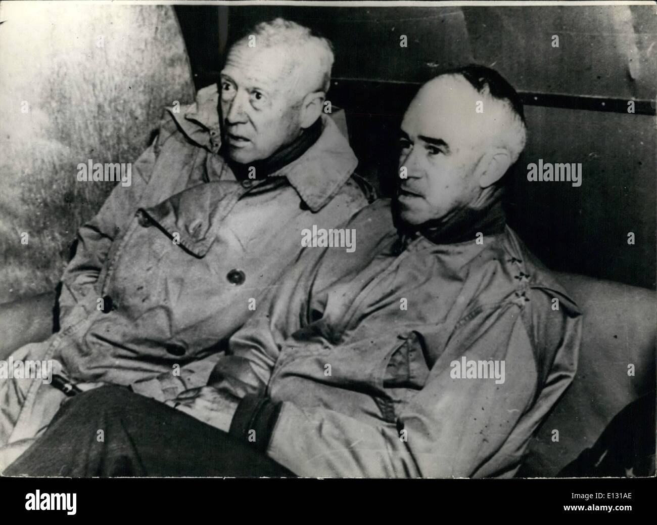 Feb. 26, 2012 - Their armies keep them flying passed by Censor. Lt. Generals George . Patton (left) and Omar L. Bhadley, are shown in a C - 47 transport plane in which they visited the different frighting areas in Noryhern France. The Ya forces are now spread so widely tha the top field commanders find it necessary to use planes to inspect the various Fronts, Stretoning Brittany to the Duch, German, Swiss and Italian borders. - Stock Image