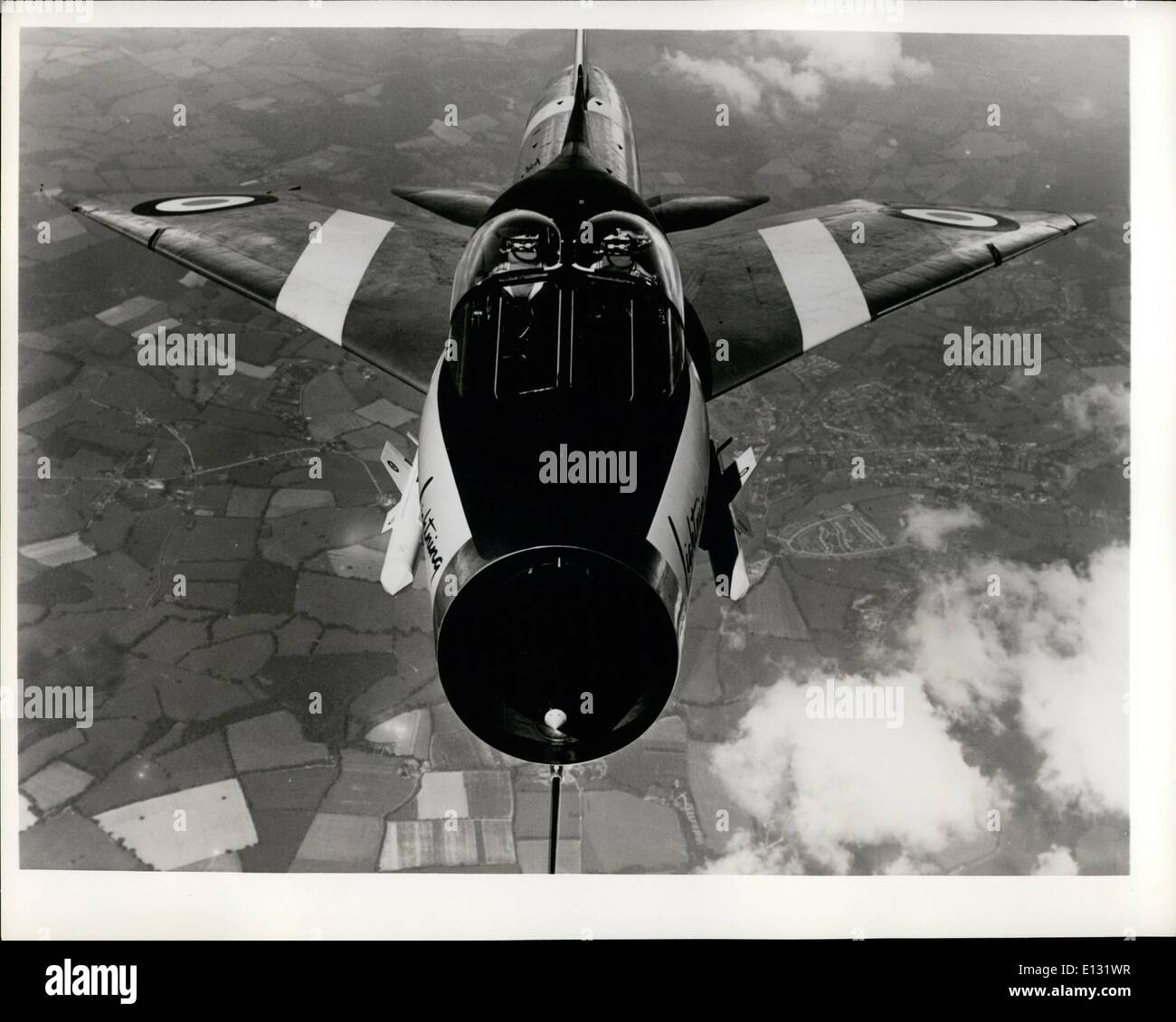Feb. 26, 2012 - Supersonic Bug. Head-on air shot of the English Electric P.11 Lightning two-seater trainer over Hampshire, England, gives it the appearance of a bug. Said to have flown at approximately twice the speed of sound, the trainer version of Britain's fastest all-weather jet fighter is on order for the Royal Air Force. It will be delivered with provision for a full weapon system so that it can also be used as an operational aircraft. Part of the weapon system, two firestreak guided missiles are shown on either side of the fuselage. - Stock Image
